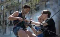 Students securing safety harness in courtyard